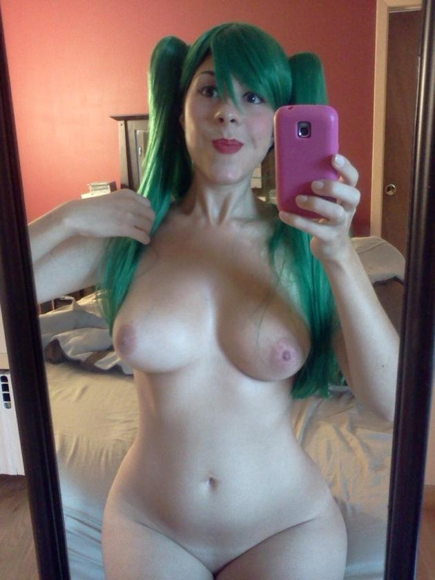 Sexy punk rock babe using a pair of toys on herself 5